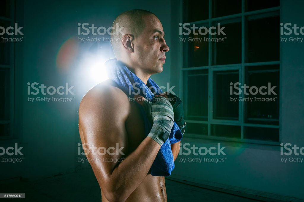 The young man kickboxing on black background stock photo
