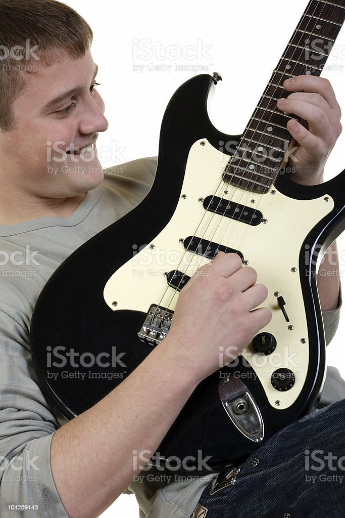 The young man with a guitar royalty-free stock photo