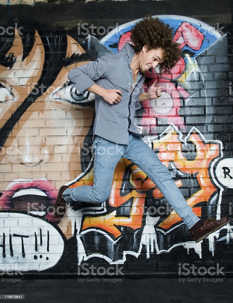 The young man with curly hair royalty-free stock photo