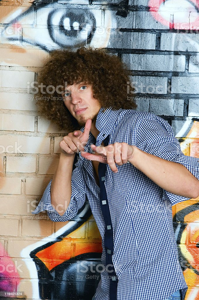 The young man with curly hair stock photo
