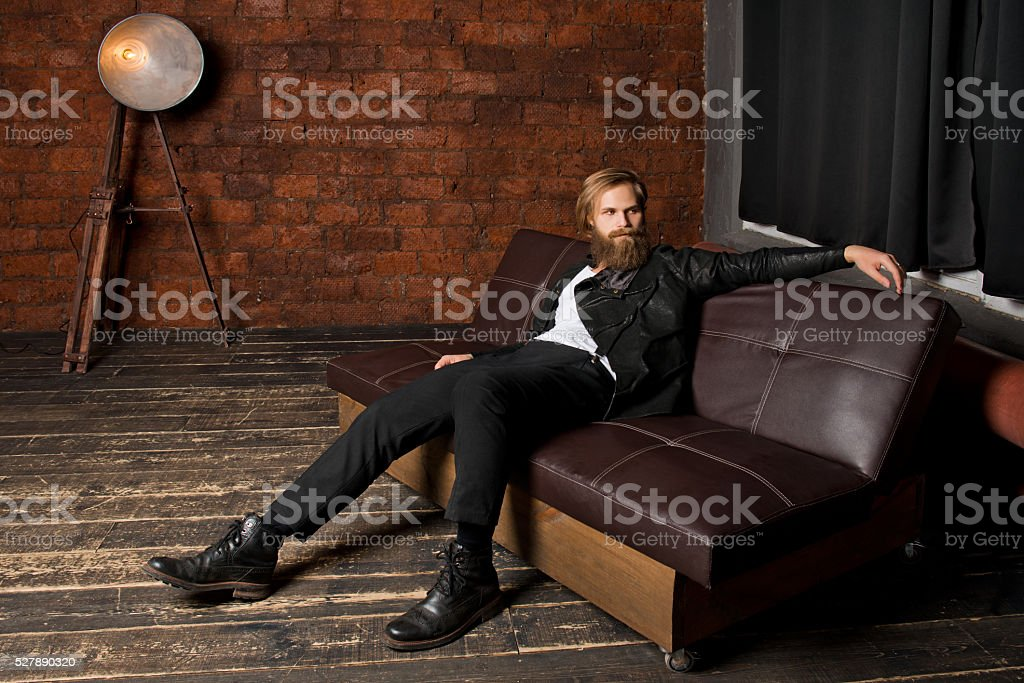 the young man with long hair stock photo