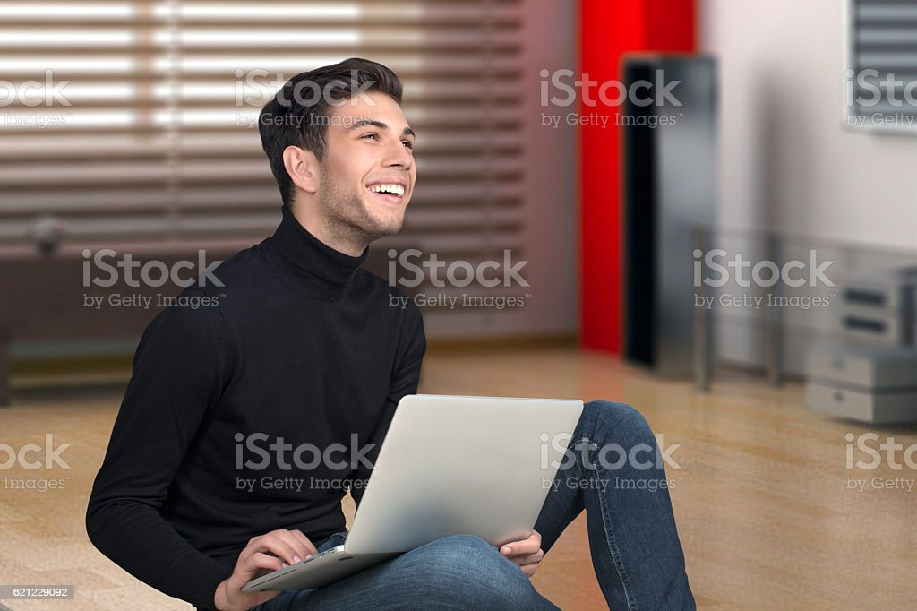 the young man with the laptop  smilles stock photo