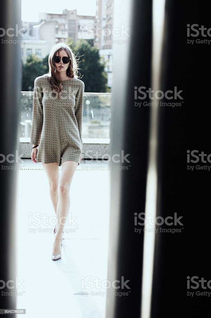 The young successful woman walking in the big city stock photo