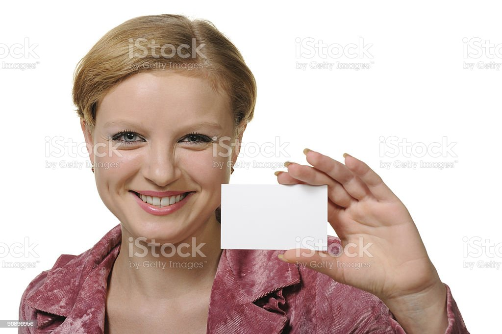 The young woman holding a business card royalty-free stock photo