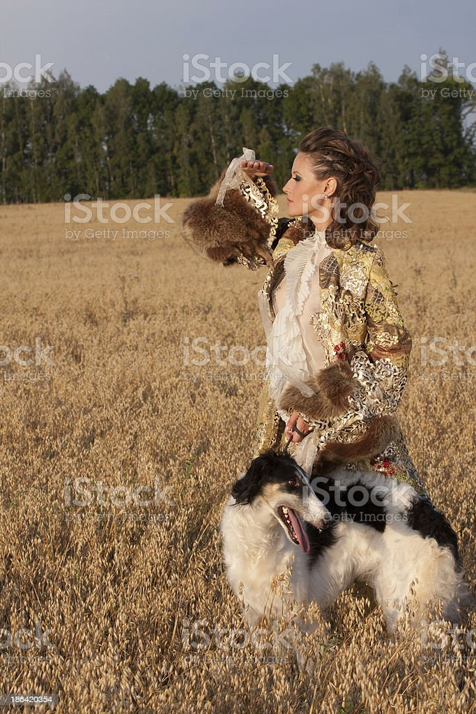 The young woman in clothes of 18 centuries royalty-free stock photo