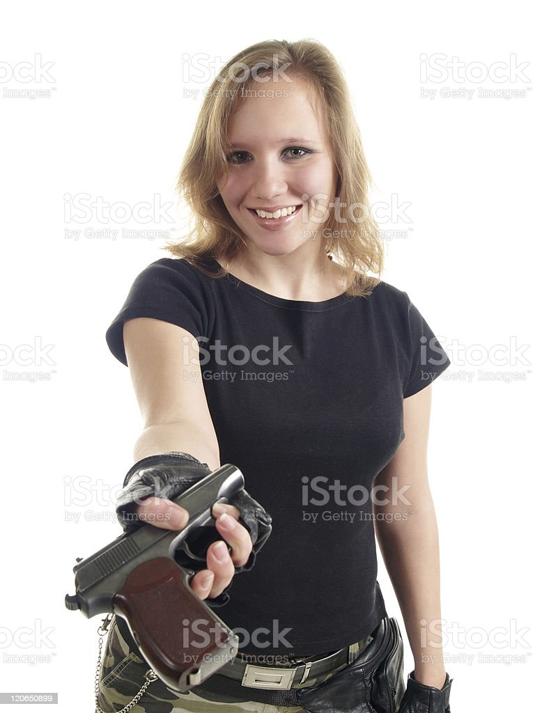 The young woman with a pistol royalty-free stock photo