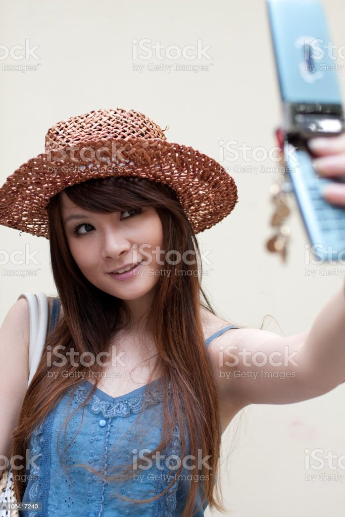 the young woman with handphone stock photo