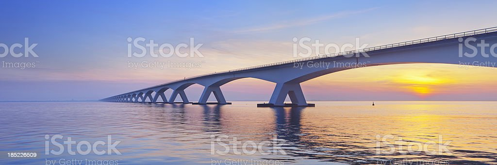 The Zeeland Bridge in Zeeland, The Netherlands at sunrise stock photo