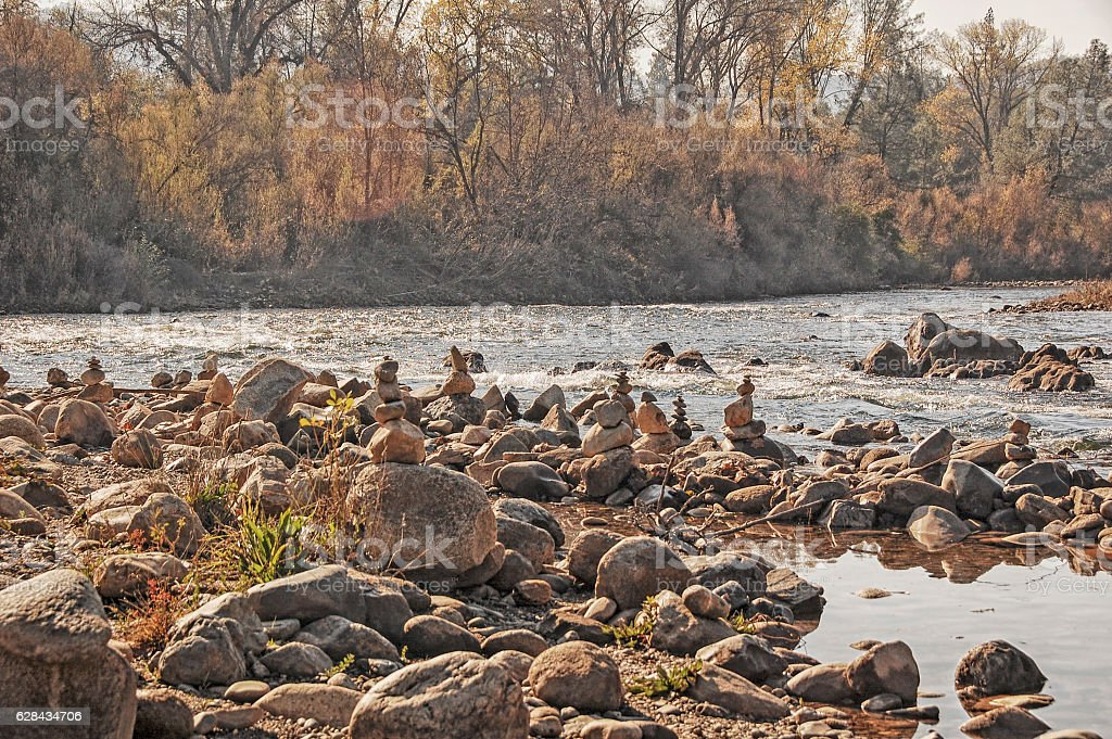The Zen of Stacking Rocks - American River stock photo