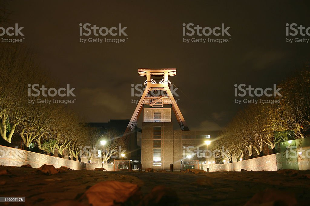 The Zollverein building lit-up at night  stock photo
