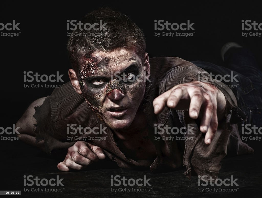 The zombie is lying stock photo
