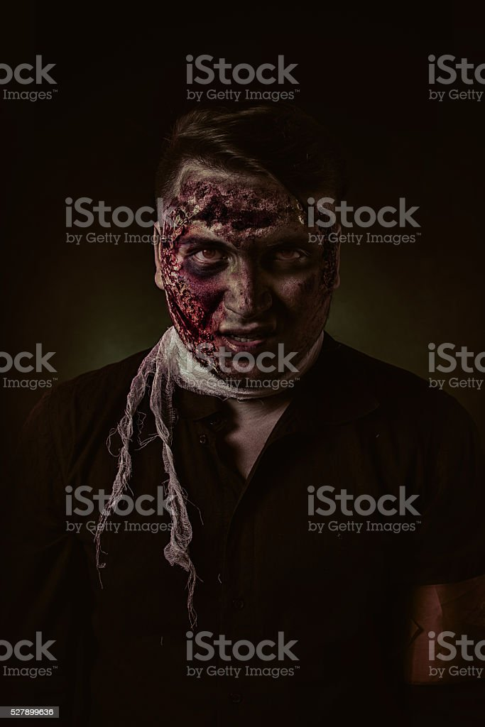 The zombie is monster in browm shirt in the studio stock photo