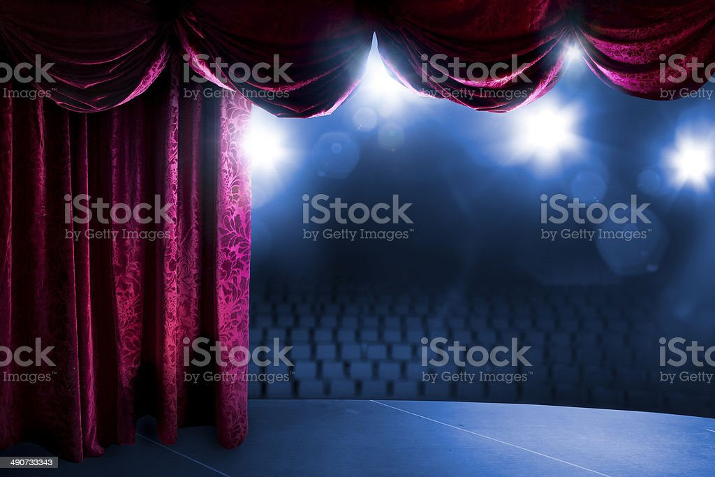 Theater curtain with dramatic lighting stock photo