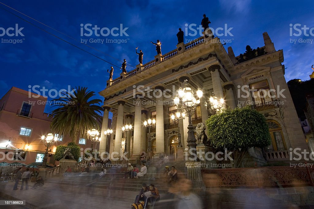 Theater Exterior at Dusk with People Milling Around stock photo