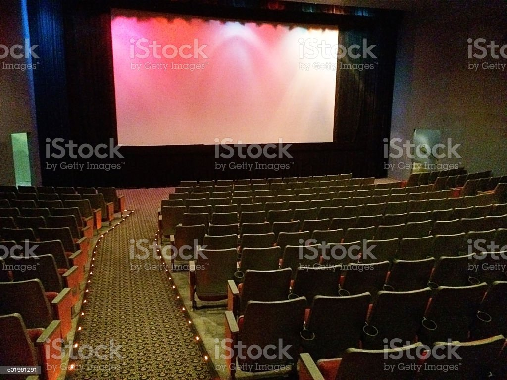 Theater Interior with Empty Seating with Screen stock photo