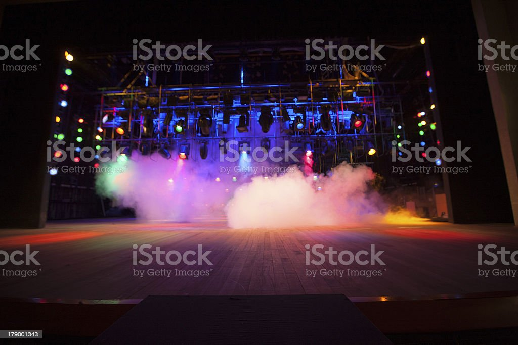 Theatrical colored lights on stage stock photo