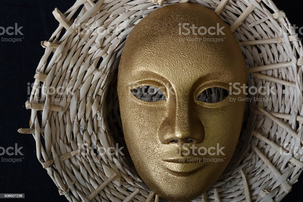 theatrical mask in a hat stock photo