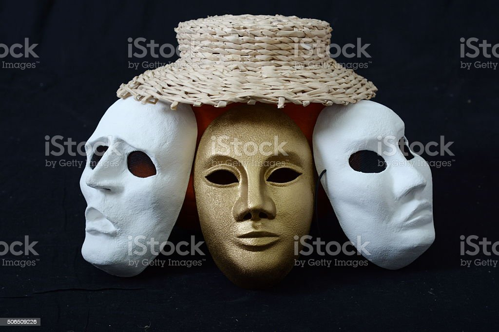 theatrical masks in a hat stock photo