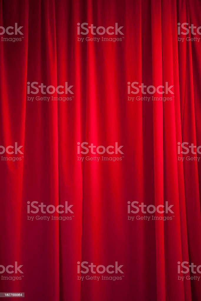Theatrical, pleated, bright red silk curtain royalty-free stock photo