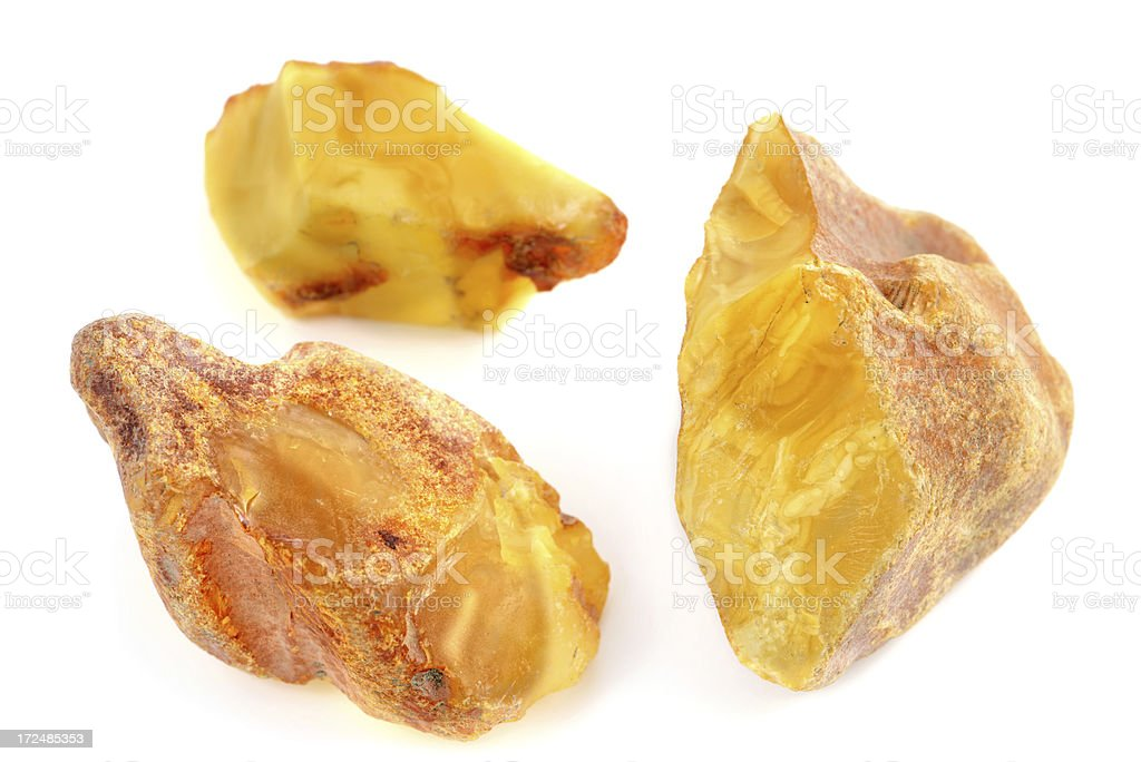 thee raw amber stones on white background stock photo