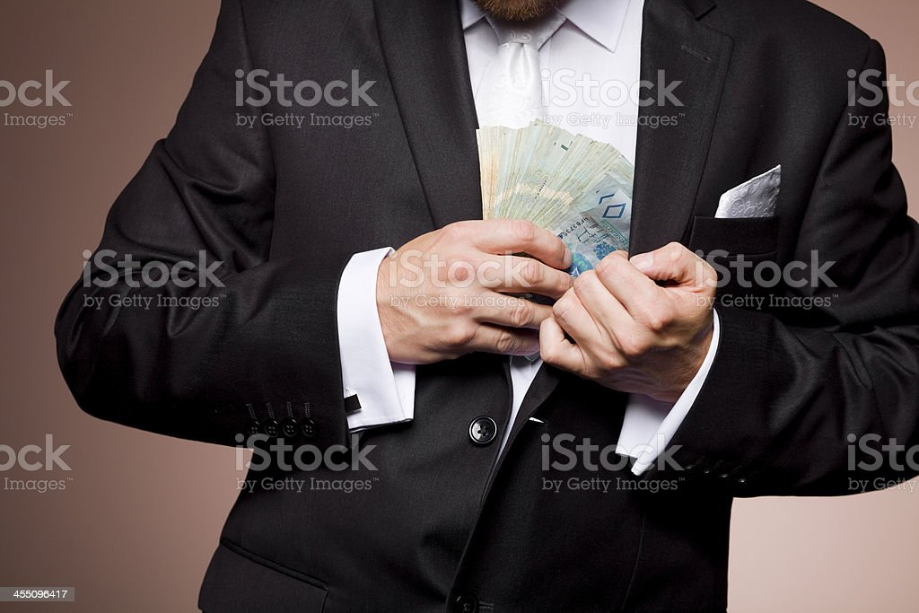 theft of money by the businessman stock photo