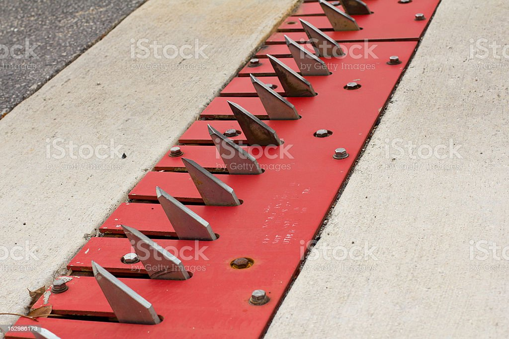 Theft prevention spikes at a parking lot stock photo