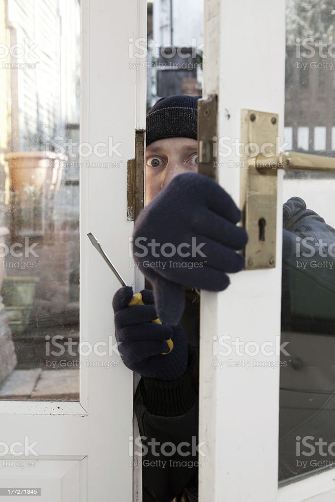 Theif breaking-in burglary security royalty-free stock photo