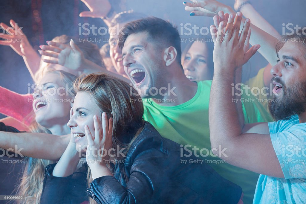 Their idol is finally on the stage! stock photo