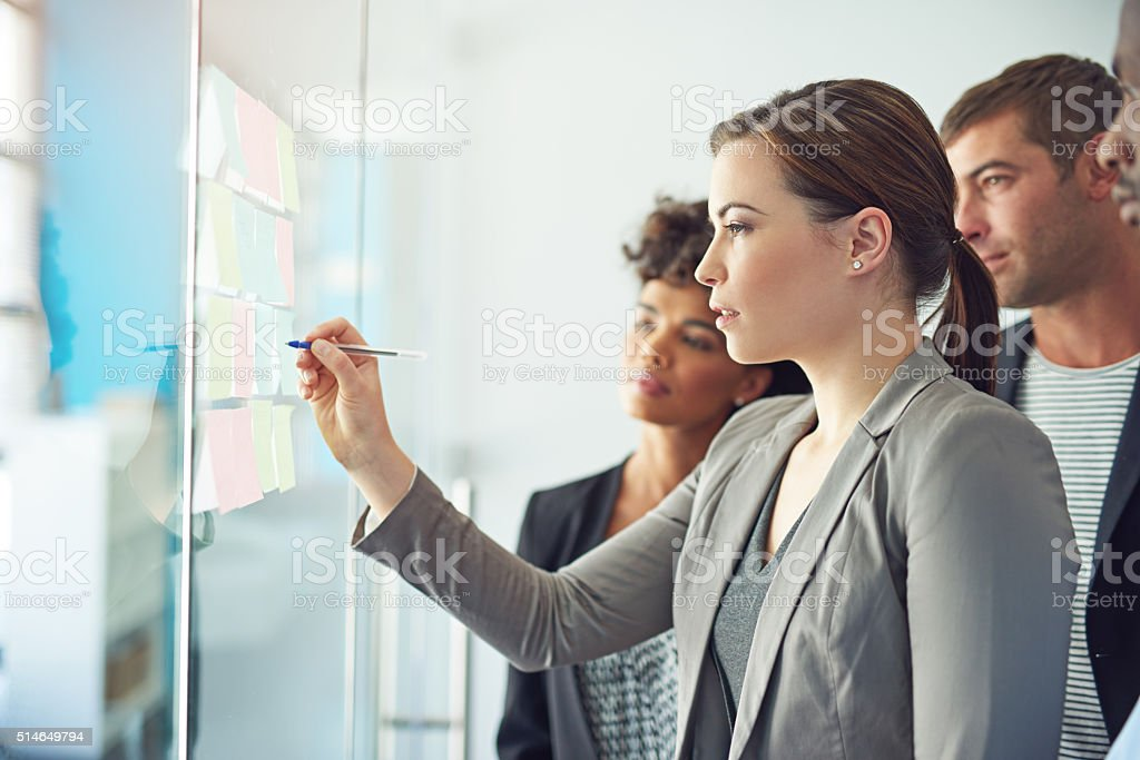 Their whole team is involved in executing a successful project stock photo