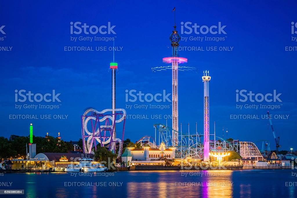Theme park rides roller coasters illuminated Grona Lund Stockholm Sweden stock photo