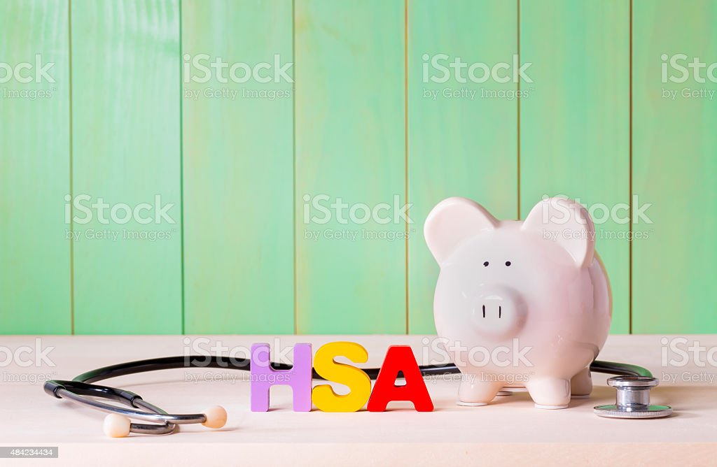 HSA theme with stethoscope and a piggy bank stock photo