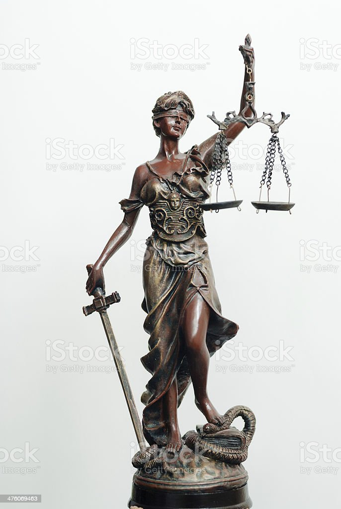 themis, femida or justice goddess sculpture on white stock photo