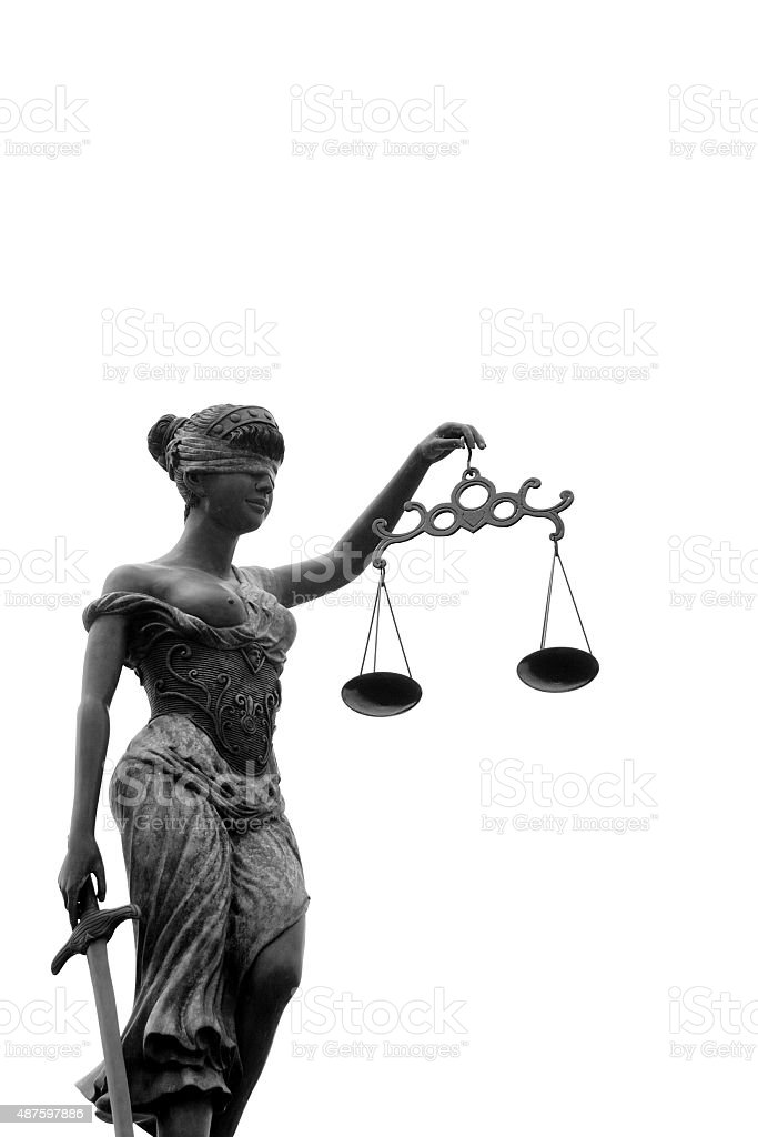 Themis Goddess holding scales of justice stock photo