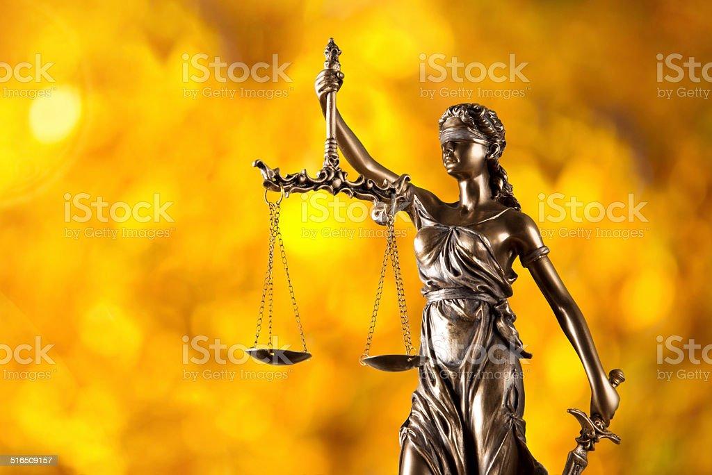 Themis in spotlight, law concept. stock photo