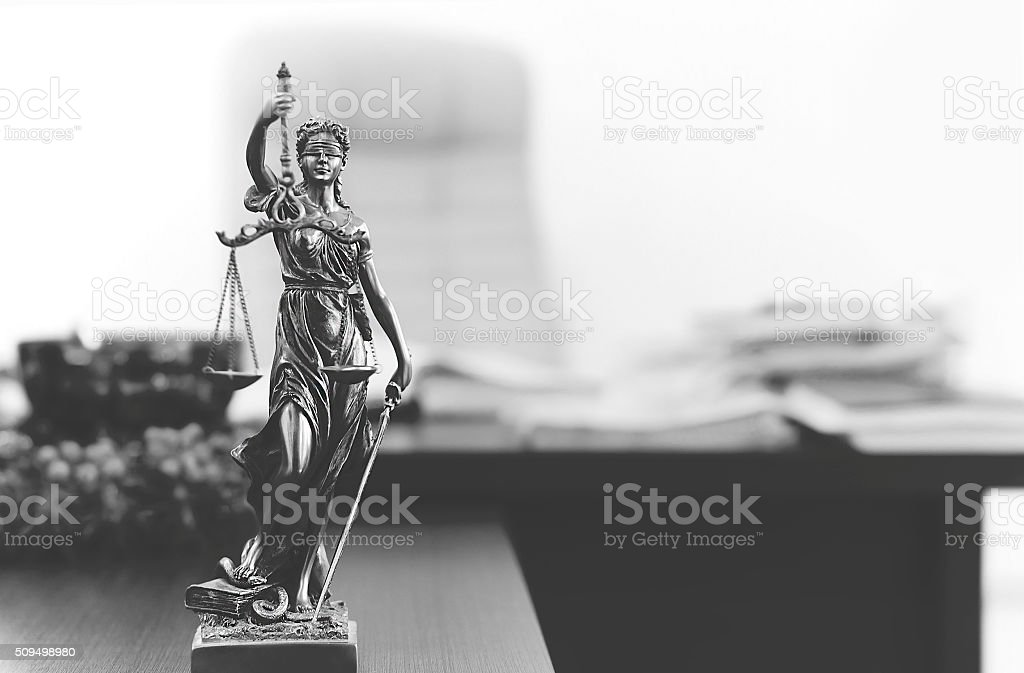 Themis statue in lawyer's office stock photo