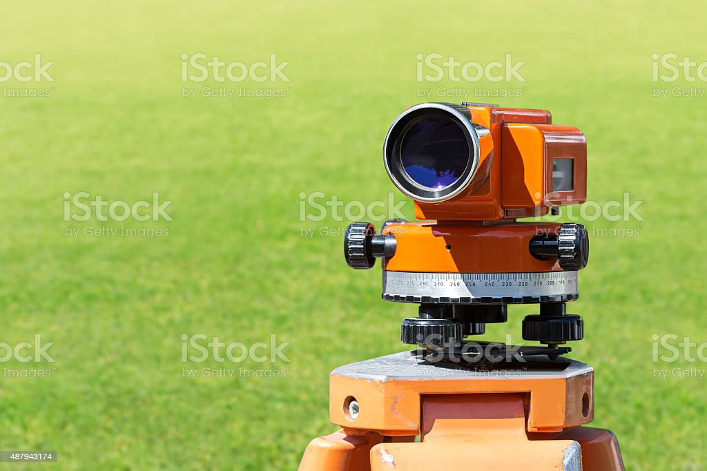 theodolite level tool mounted on tripod stock photo