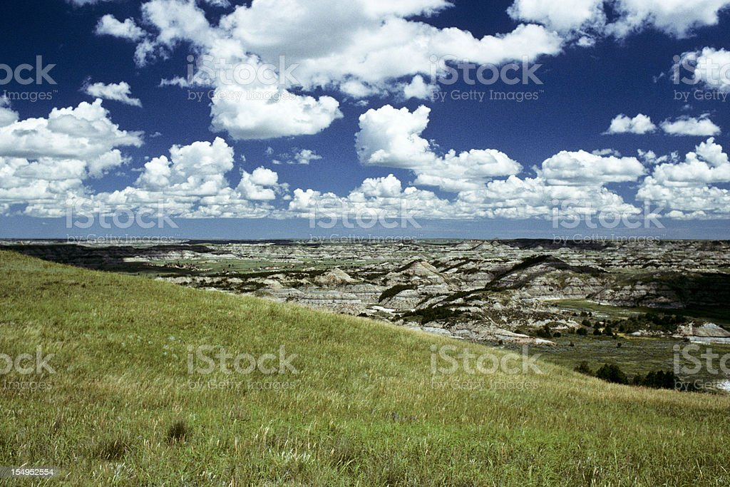 Badland Canyon, Meadow and Cloud Formation royalty-free stock photo