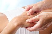 Therapeutic hand massage.
