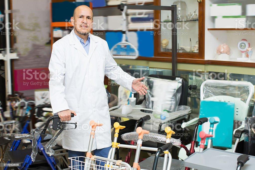 Therapeutist posing near orthopaedic equipment stock photo