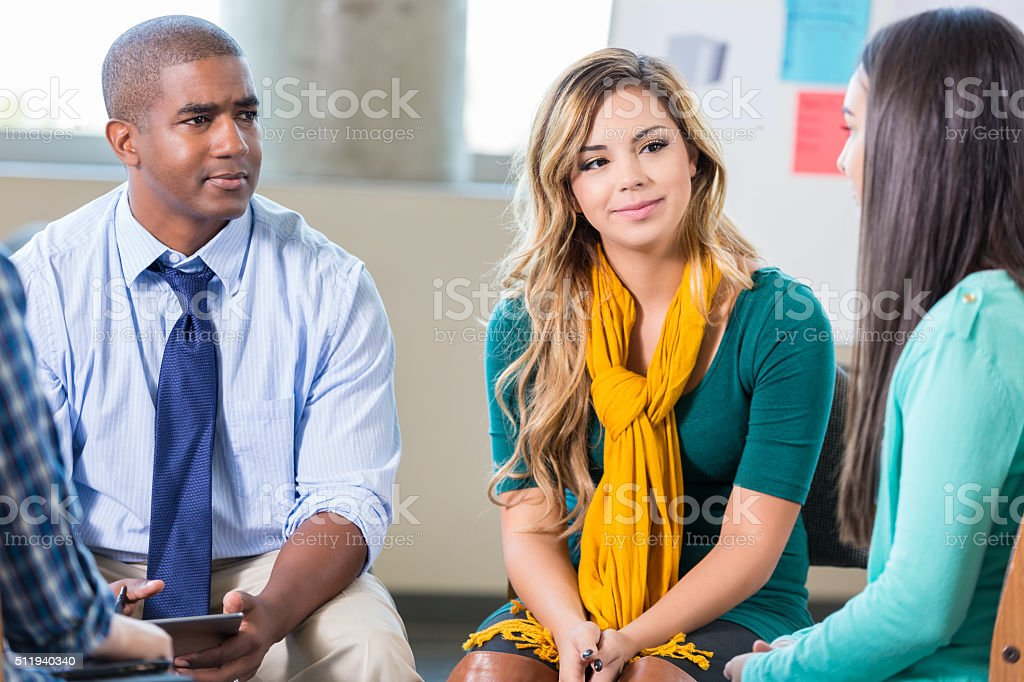 Therapist and teens in support group stock photo