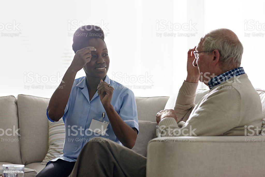 Therapist carrying out EFT treatment with elderly patient stock photo
