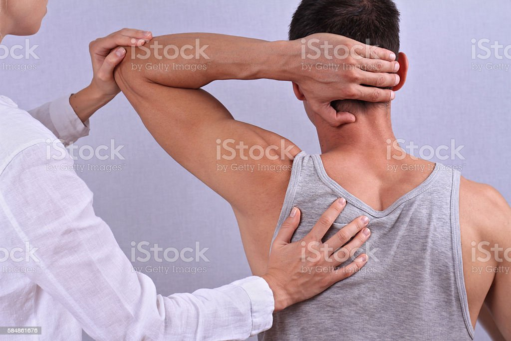 Therapist doing healing treatment on man's back stock photo