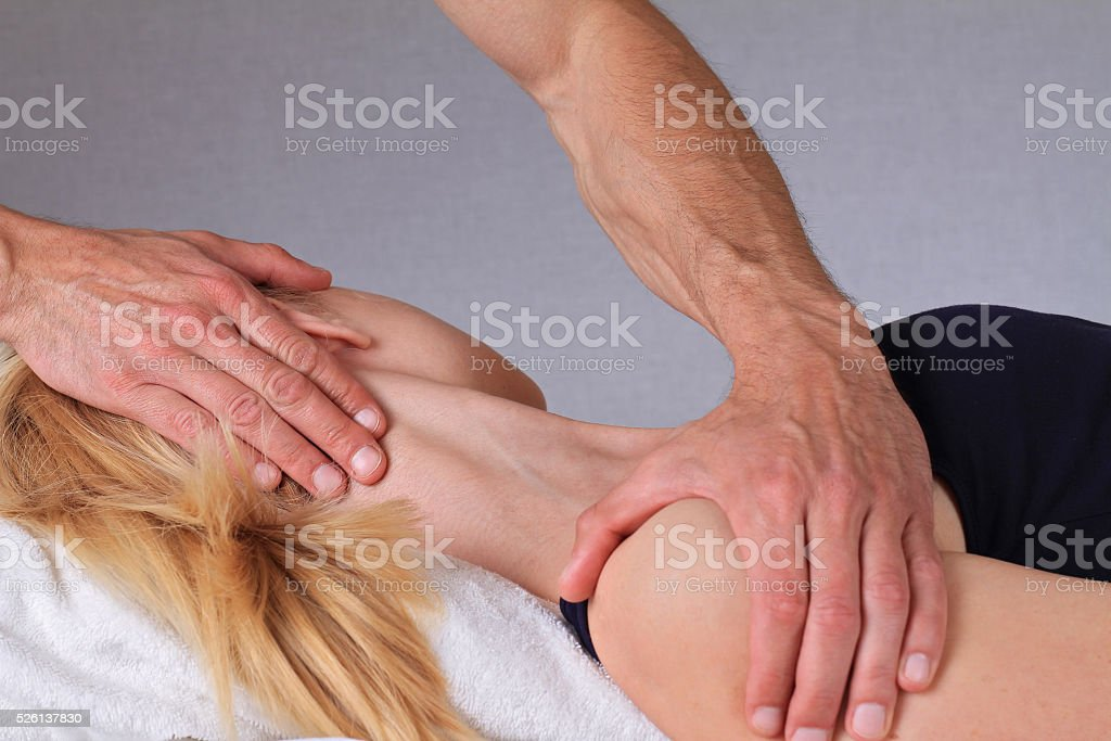 Therapist  doing healing treatment treatment on woman's neck stock photo