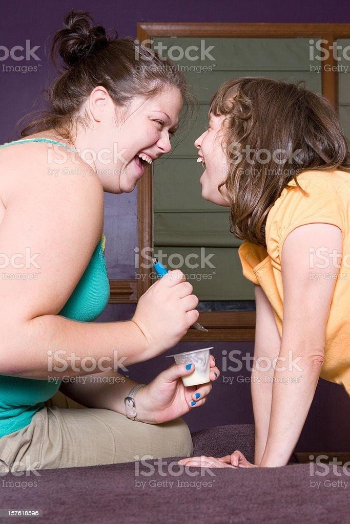 Therapist enjoying happy moment with autistic girl stock photo