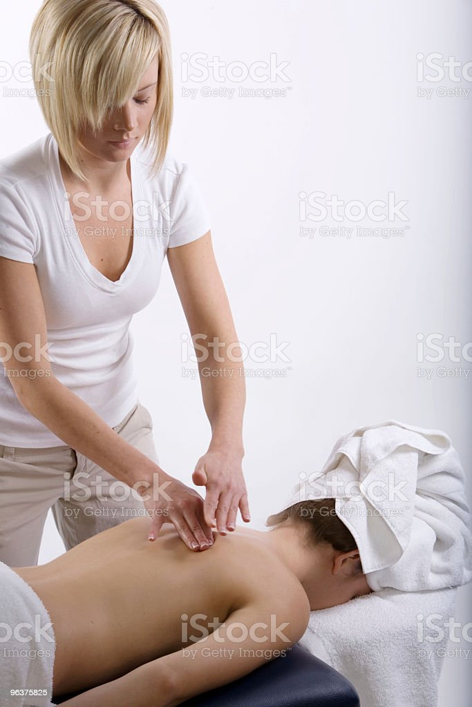 Therapist giving a massage royalty-free stock photo