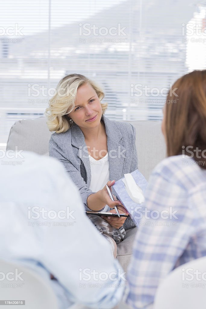 Therapist giving tissue to the wife royalty-free stock photo