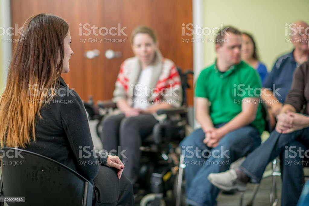 Therapist Leading a Adult Discussion stock photo