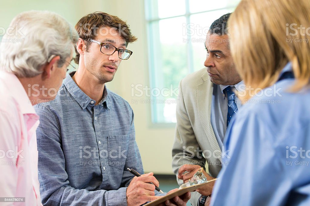 Therapist leads group therapy stock photo