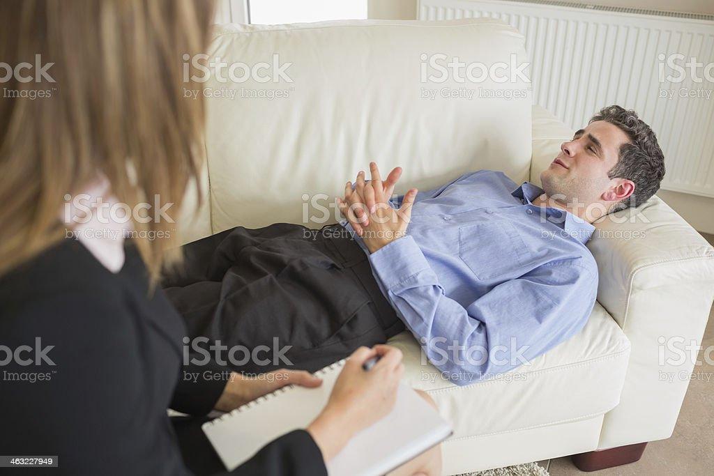 Therapist listening to man stock photo
