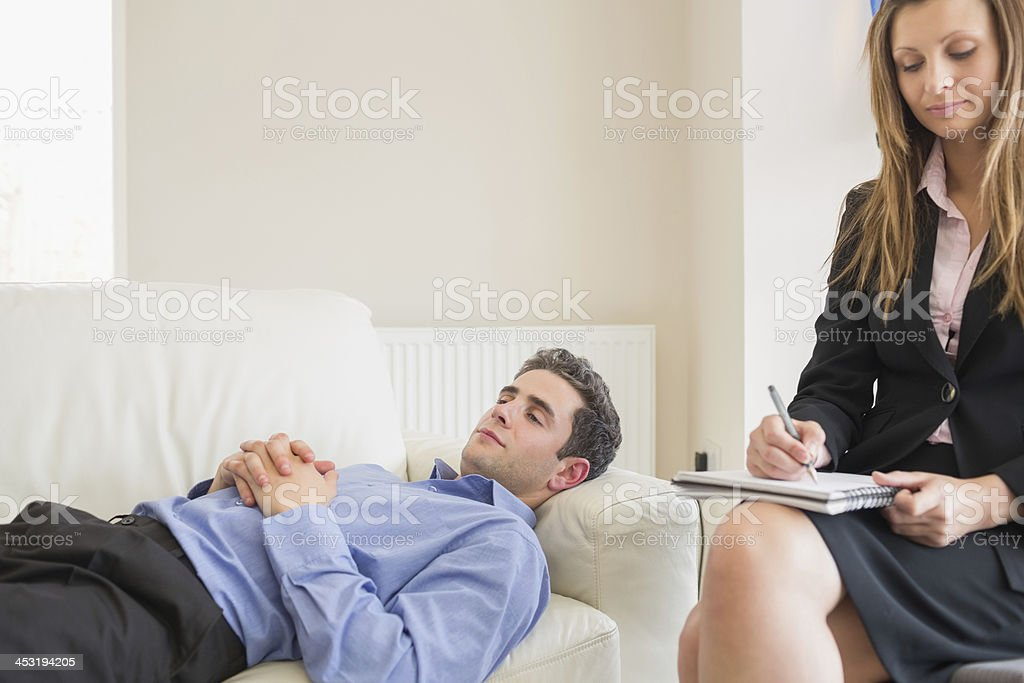 Therapist noting down the problems of her patient stock photo
